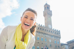 Woman in front of palazzo vecchio in florence Royalty Free Stock Images