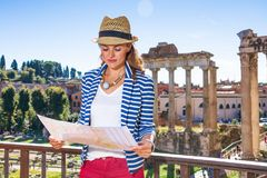 Woman in front of Roman Forum in Rome, Italy looking at map Royalty Free Stock Images