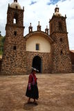Woman in front of a rural stone Church Stock Photos