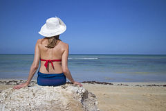 Woman in front of the sea Royalty Free Stock Photos
