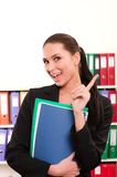 Woman in front of shelves with folders Stock Photos