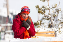 Woman in front of ski hut Royalty Free Stock Photos