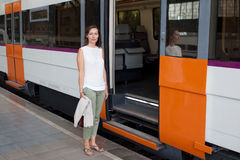 Woman in front of train Stock Images