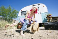 Woman in front of Travel Trailer Royalty Free Stock Image