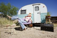 Woman in front of Travel Trailer Stock Image
