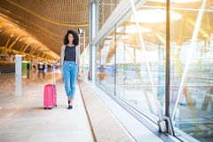 Woman front walking at the airport stock image