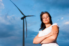 Woman in front of windmill and sky Royalty Free Stock Image