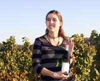 Woman in front of a wineyard Royalty Free Stock Photography