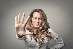 Woman frowing her face Royalty Free Stock Photography
