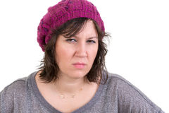 Woman frowning in disbelief with an assessing look Stock Photography
