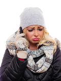 Woman frowning on the phone. A woman dressed for winter is frowning while talking on the cell phone stock photo