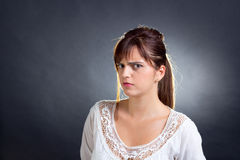 Woman frowning Stock Photo