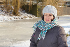 Woman by a frozen lake Royalty Free Stock Images