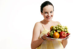 The woman with fruit Royalty Free Stock Images