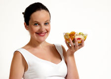 The woman with fruit Royalty Free Stock Photos