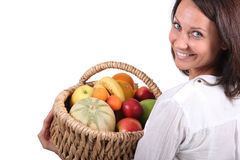 Woman with fruit basket Royalty Free Stock Photos