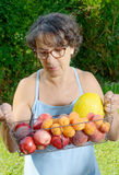 Woman with a fruit basket Stock Photo