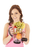 Woman fruit blender smile Stock Photography