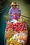 Woman in fruit boat in bangkok floating market. Thai woman selling fruit at floating market near Bangkok, Thailand Royalty Free Stock Image
