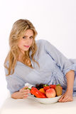 Woman with Fruit Bowl Stock Photography