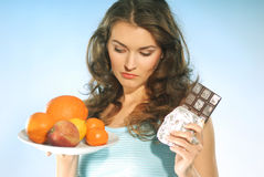 Woman with fruit and chocolate Stock Image