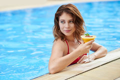 Woman with fruit cocktail Royalty Free Stock Photo