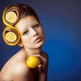 Woman with fruit in hair Royalty Free Stock Photos