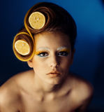 Woman with fruit in hair Stock Image