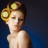 Woman with fruit in hair Stock Photos