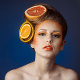 Woman with fruit in hair Stock Photography