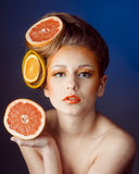 Woman with fruit in hair Royalty Free Stock Photography