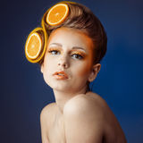 Woman with fruit in hair Stock Photo