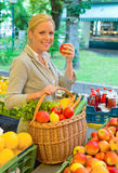 Woman at the fruit market stock photography