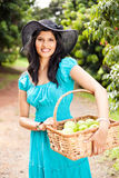 Woman in fruit orchard Royalty Free Stock Photo