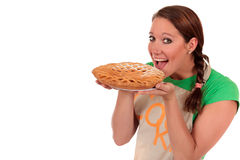 Woman fruit pie. Attractive woman displaying fruit pie. Studio, white background stock photo