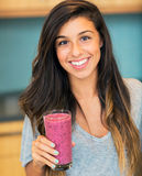 Woman with Fruit smoothie Royalty Free Stock Photos