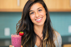 Woman with Fruit smoothie Royalty Free Stock Photography
