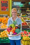 Woman at the fruit and vegetable market stock images