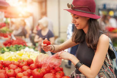 Woman at the fruit and vegetable market Royalty Free Stock Photography