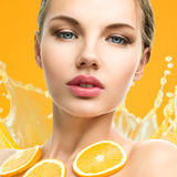 Woman with fruit Stock Photography