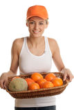Woman with fruits in basket Royalty Free Stock Images