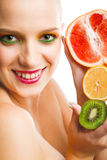 Woman with fruits Stock Photos