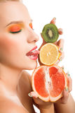 Woman with fruits Stock Photography