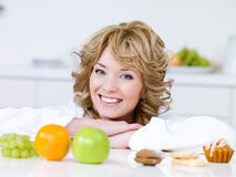 Woman with fruits and cakes Royalty Free Stock Photography