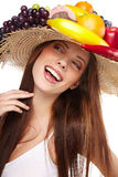 Woman with fruits headwear. Stock Images