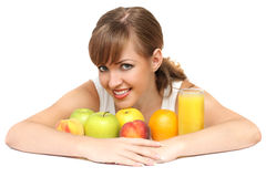 Woman with fruits and juice. Beautiful woman with fruits and juice Stock Image