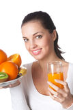 Woman with fruits and juice Royalty Free Stock Image