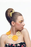 Woman with fruits. Woman with orange lemon fruit isolated on a white Stock Photos