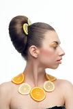 Woman with fruits. Woman with orange lemon fruit isolated on a white Royalty Free Stock Images