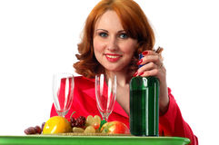 Woman with fruits and some wine. Portrait, isolated on white royalty free stock photography
